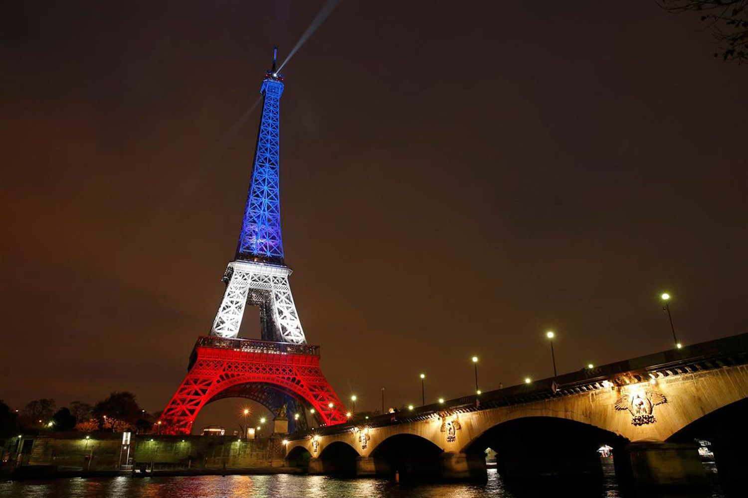 Eiffel Tower glows in French Colors