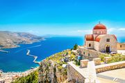 Remote church with red roofing on cliff, Greece | © Fotolia